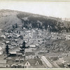 Title: Deadwood, [S.D.] from Engleside<br /> Overview of homes and commercial buildings in small city; trees and mountains in background. 1888.<br /> Repository: Library of Congress Prints and Photographs Division Washington, D.C. 20540