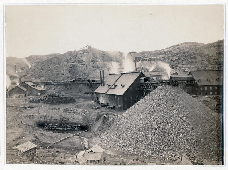 "Title: ""Mills and mines."" Part of the great Homestake works, Lead City, Dak.<br /> Bird's-eye view of mining factory, Homestake Works. 1889.<br /> Repository: Library of Congress Prints and Photographs Division Washington, D.C. 20540"