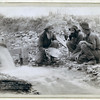 "Title: ""We have it rich."" Washing and panning gold, Rockerville, Dak. Old timers, Spriggs, Lamb and Dillon at work<br /> Three men, with dog, panning for gold in a stream. 1889.<br /> Repository: Library of Congress Prints and Photographs Division Washington, D.C. 20540"
