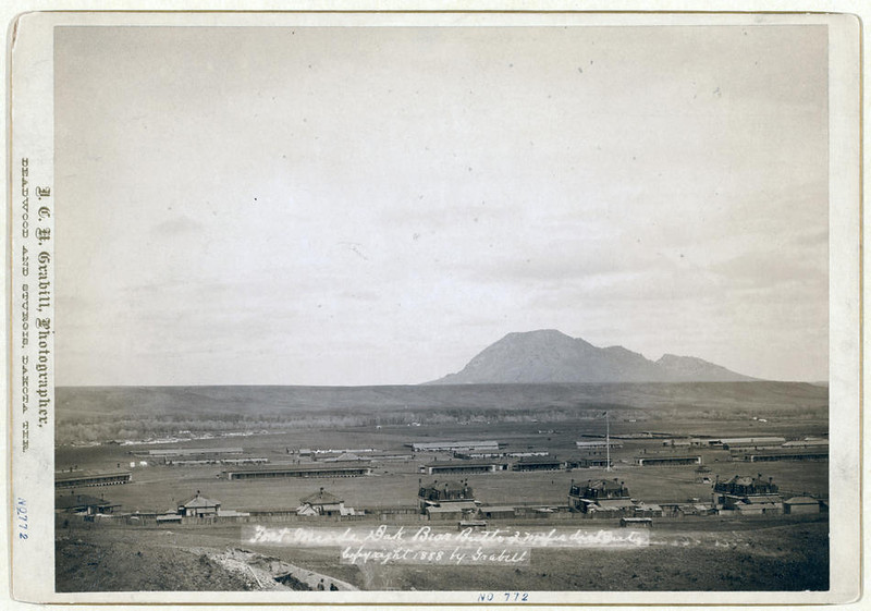 Title: Fort Meade, Dakota. Bear Butte, 3 miles distant<br /> Bird's-eye view of military camp buildings; butte in background. 1888.<br /> Repository: Library of Congress Prints and Photographs Division Washington, D.C. 20540