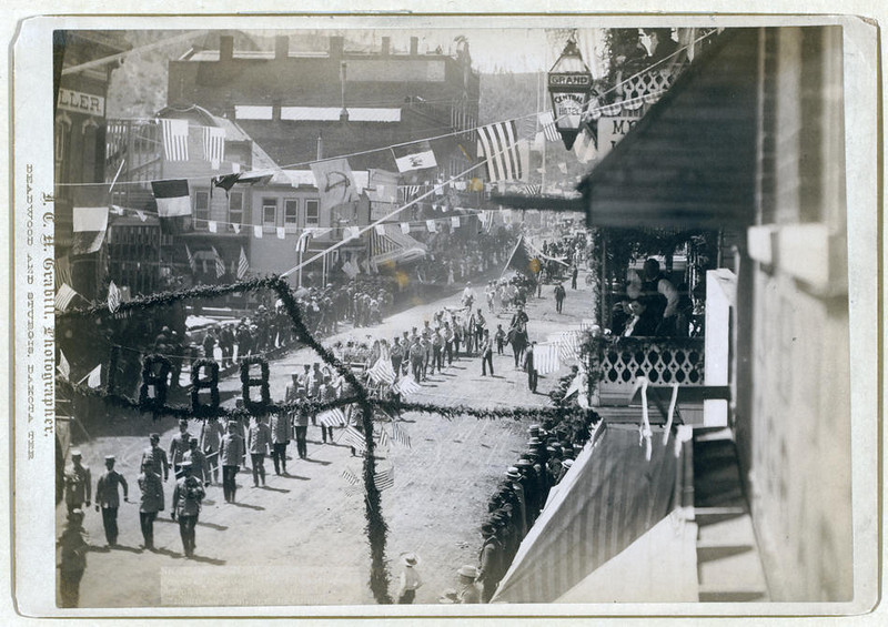 "Title: People of Deadwood celebrating completion of a stretch of railroad<br /> Street parade with numbers ""1888"" in foreground. 1888.<br /> Repository: Library of Congress Prints and Photographs Division Washington, D.C. 20540"