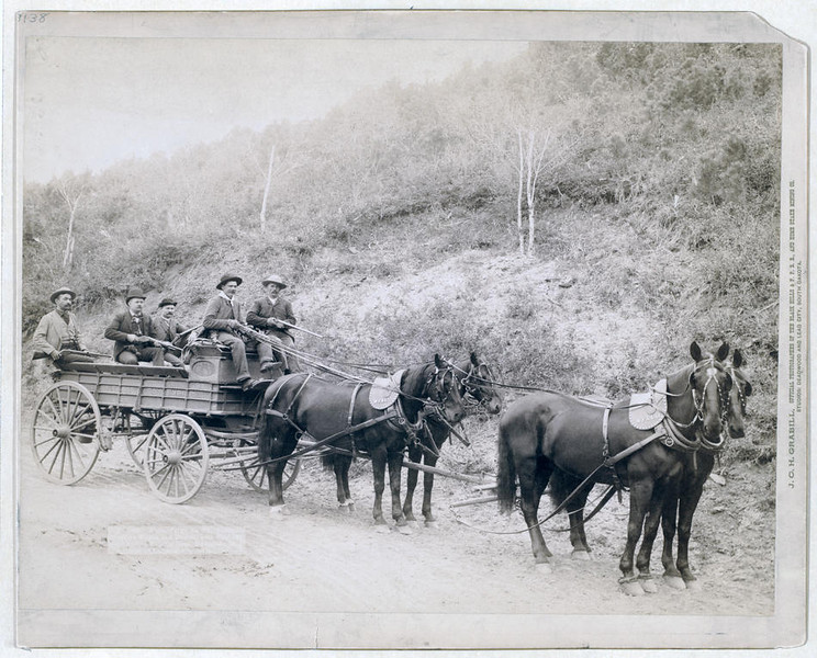 Title: Wells Fargo Express Co. Deadwood Treasure Wagon and Guards with $250,000 gold bullion from the Great Homestake Mine, Deadwood, S.D., 1890<br /> Five men, holding rifles, in a horse-drawn, uncovered wagon on a country road.<br /> Repository: Library of Congress Prints and Photographs Division Washington, D.C. 20540