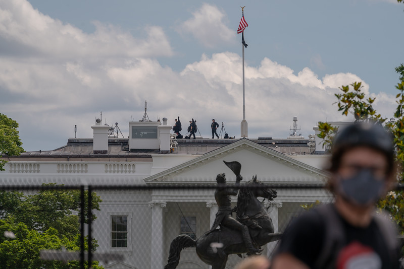 Secret Service on top of The White House.