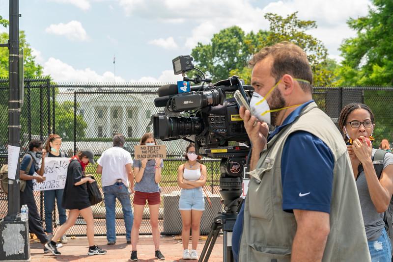 A news crew, and a woman eats an apple.
