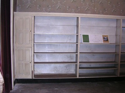 A built-in bookcase was installed somewhere along the way. From it's appearance, I would guess it dates from the 1950s or '60s.
