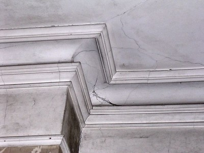 All four main rooms have magnificent, perfectly crafted plaster crown molding. (The dark lines are not marbling, but dirt and water damage.)