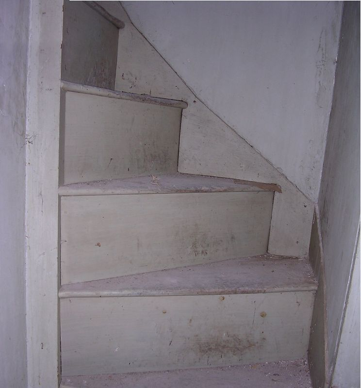 Because the ceilings are lower in the addition, the levels don't match up, and a series of short stairways connects them. This spiral stairway is a half flight leading up from a landing to the semi-finished attic over the addition.