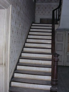 The house is a traditional old southern mansion with a center hall and two large connecting rooms on either side.  This is the entry hall and main staircase.