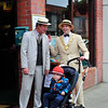 Bill Gleeson with An Cathaoirleach Cllr Cormac Devlin and his son Cillian outside The Wine Buff and Odells Bistro in Glasthule on Bloomsday 2016. Photograph: Margaret Brown 2016