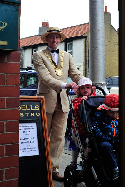 An Cathaoirleach Cllr Cormac Devlin with his children Cillian and Torah outside Odells Bistro in Glasthule on Bloomsday 2016. Photograph: Margaret Brown 2016