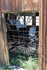 <h2>Caged</h2>The old buggy is just waiting to go someplace.  For now it is stuck in this barn in Bodie.