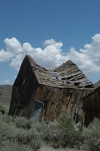 Bodie is supposed to be kept in a static state of decay - they are trying to keep it as-is without further decay.  On many buildings you can see the additional support added to help the building.  I think that they are losing on this small barn! :)