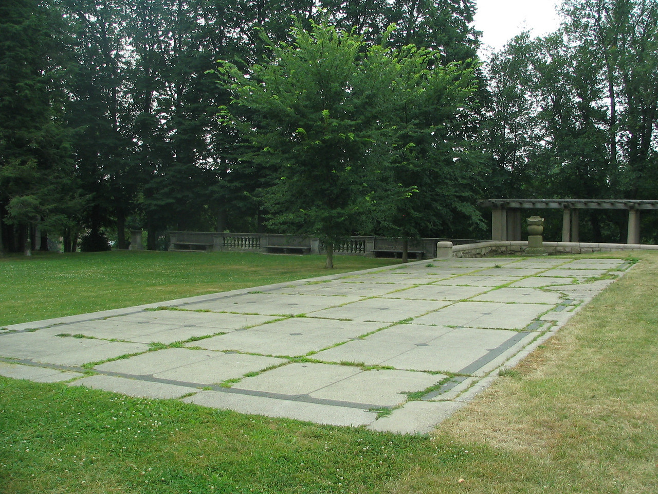 Terrace. The former terrace of the main residence. The house would have sat immediately to the right. The bowling green on the left. You can still make out the pattern of the fountain that abutted the house. Many of Mr. Anderson's prized bansai trees were displayed here.