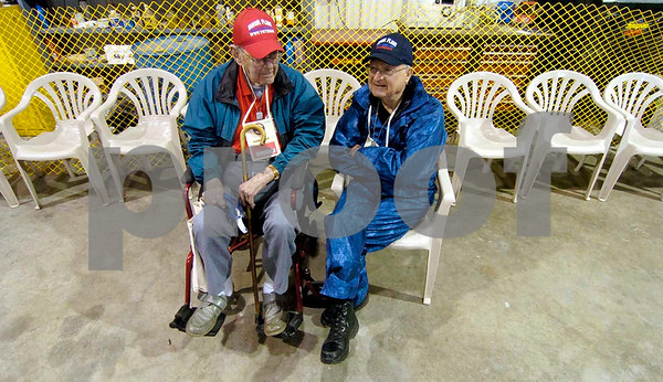 -Messenger photo by Hans Madsen<br /> <br /> John Hedges, left, of Lorenz, an Air Force veteran from the Korean War, chats with his guardian, Bob Dallenbach, of Lorenz, while they wait to board the Saturday Brushy Creek Honor Flight to Washington D.C. Dallenbach served in Vietnam.