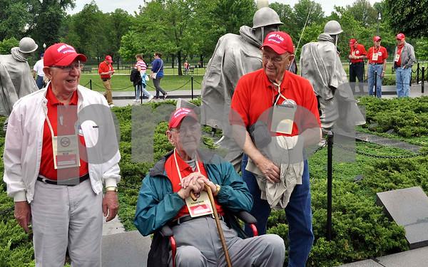 Joseph Sobotka, John Hodges and Dean Seehusen pause for a photo at the Korean War Veterans Memorial.