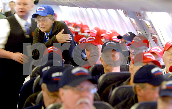 -Messenger photo by Hans Madsen<br /> <br /> World War II and Korean War veterans get comfortable in their seats Saturday morning as they prepare to depart Fort Dodge on the Brushy Creek Area Honor Flight to Washington D.C. Dr. Janet Secor, who was along as a medical volunteer, looks over the cabin.