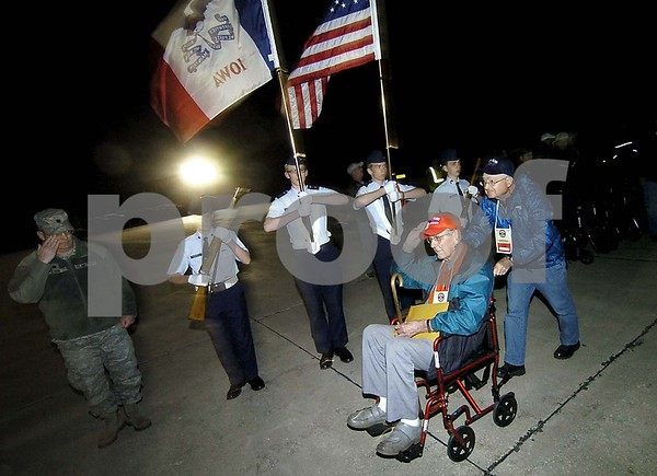 -Messenger photo by Hans Madsen<br /> <br /> John Hodges, left, of Laurens, returns a salute Saturday night upon his return from the Brushy Creek Area Honor Flight to Washington D.C. Hodges served in the Air Force. His guardian, Bob Dallenbach, also of Laurens, follows at right.