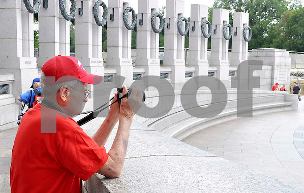 -Messenger photo by Jesse Helling<br /> <br /> Army veteran George Maze takes a photo at the World War II Memorial.