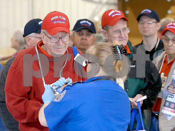 -Messenger photo by Hans Madsen<br /> <br /> Paul Stephenson, of Fort Dodge, clears security Saturday morning at the Fort Dodge Regional Airport before boarding the Brushy Creek Area Honor Flight to Washington D.C. Stephenson served in the Air Force.