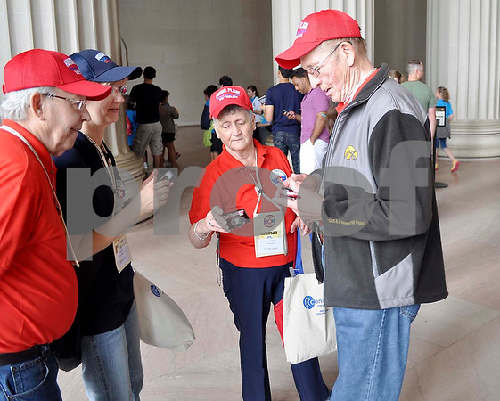 -Messenger photo by Jesse Helling<br /> Touring the Lincoln Memorial are, from left, veteran Charles Lombard, guardian Cynthia Meek and veterans Corrine Canon and Eugene Swalla.