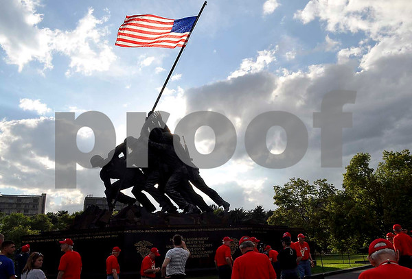 -Messenger photo by Jesse Heling<br /> <br /> Veterans convene at the United States Marine Corps Memoral near Arlington National Cemetery. The monument depicts an iconic scene of Marines raising the flag on Mount Suribachi on the island of Iwo Jima in 1945.