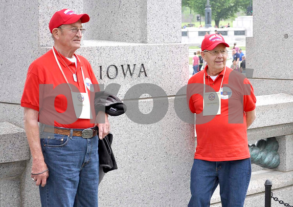 -Messenger photo by Jesse Helling<br /> <br /> George Maze, left, and Charles Lombard pose for a photo at the Iowa pillar at the World War II Memorial. The monument features pillars commemorating each U.S. state and territory.