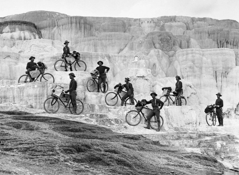 """Bicyclists' group on Minerva Terrace.  [Lt. James A. Moss's company of 25th Infantry, U. S. Army Bicycle Corps, from Fort Missoula, Montana.]  YNP."" <br /> October 7, 1896."