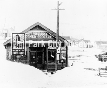 Owned and operated by Andrew Petersen from 1914 to 1927. Located on west side of Park Avenue just north of Heber Avenue.  Andy's daugher, Wave, was known to share candy from the store at the Orpheum Theater matinee.  circa 1920. (Image: 1984.17.7, Gary Kimball Collection)