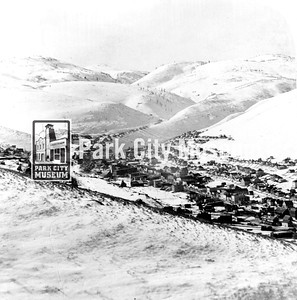View from Masonic Hill south. Rossi Hill on left.  Main Street through center.   Hills are bare, lumber being used in mining and construction.  circa 1900  (Image: 1990.14.3)