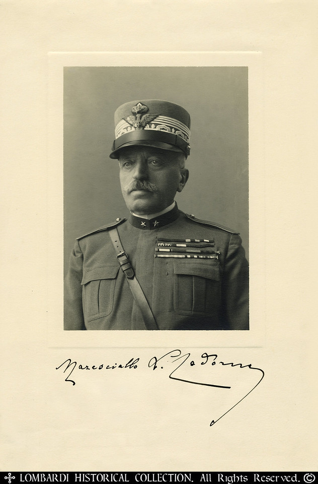 "COMMANDO SUPREMO, GENERAL LUIGI CADORNA<br /> <br /> Signed photograph, 7 3/8"" x 11 ¼"", of World War One Italian Commando Supremo, General Luigi Cadorna (1850?1928). He directed eleven major battles with limited results. He is credited with the successful defense in the Trentino (1916), the capture of Gorizia (1916), and the victory at Baensezza (1917). Replaced by Gen. Armando Diaz after the Fall of Caporetto. Cadorna, a poor tactician, with a 19th Century mind set (a common trait of old school military leadership during the Great War), threw his army away in repeated suicidal frontal assaults. A brutal disciplinarian, he implemented the rule of strict military punishment, by resurrecting the ancient Roman Army's practice of 'Decimation', in which one man in ten was picked at random and shot to death as an example to others. In this way, 750 Italian soldiers were executed during WW1.<br /> <br /> [Image Copyright, the Lombardi Historical Collection, All Rights Reserved]"