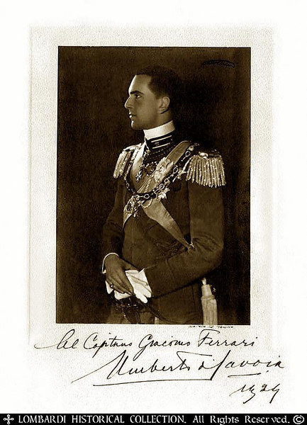 "UMBERTO DI SAVOIA<br /> <br /> Only son of King Victor Emmanuel III of Italy and <br /> Queen Elena.<br /> .<br /> <br /> Hand signed photo of UMBERTO DI SAVOIA (Humbert II), (1904-83), last king of Italy (1946), son and successor of Victor Emmanuel III. On the abdication (May, 1946) of his father, who was tainted by his long acquiescence (1922–43) to Fascist rule, Humbert succeeded to the throne, pending a referendum on the monarchy. The referendum (June, 1946) resulted in the establishment of a republic, and Humbert went into exile in Portugal. Hand signed photograph, dedicated by Umberto di Savioa in 1924 to Captain Giacomo Ferrari, who later became the leading commander of the anti-Nazi Partisan forces in the western region of Italy during WWII. 16"" x 11"". Torino, Italy"