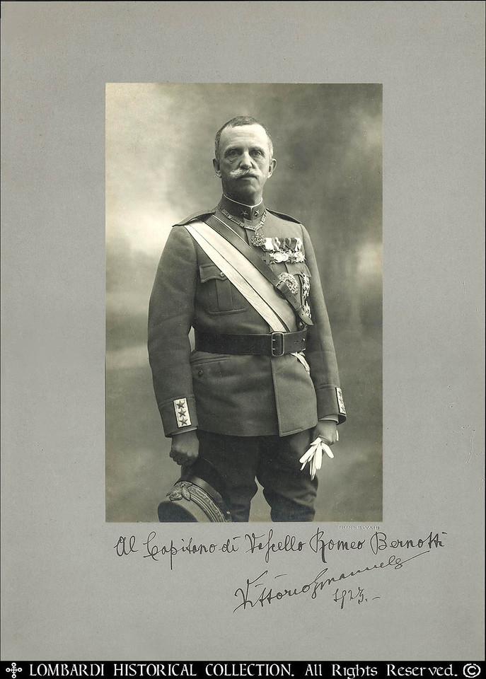 "ITALIAN KING VITTORIO EMANUELE III<br /> <br /> (1869 – 1947) Hand signed studio photograph with original signature autograph and inscription by the King, presented to a Italian Navy Regia Marina Captain Romeo Bernotti, dated 1923. 14"" x 10"".<br /> <br />  <a href=""http://it.wikipedia.org/wiki/Romeo_Bernotti"">http://it.wikipedia.org/wiki/Romeo_Bernotti</a><br /> <br /> Fotograzia con autografo original di Re Vittorio Emanuele al capitano di vascello Romeo Bernotti"