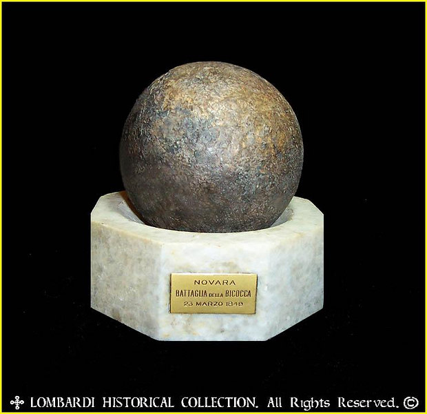 """FIRST WAR OF ITALIAN UNIFICATION<br /> <br /> Cannonball fired at the BATTLE OF NOVARA (Battle of Bicocca), March 23, 1849. One of the first battles of the Italian Risorgimento. 7-pounder, 13"""" circumference.<br /> <br /> """"The Battle of Novara or Battle of Bicocca (Bicocca is a borough of Novara) was one of the battles fought between the Austrian Empire and the Kingdom of Sardinia during the First Italian War of Independence, within the era of Italian unification. Lasting the whole day of March 22, 1849 and ending at dawn on March 23, it resulted in a severe defeat and retreat of the Piedmontese (Sardinian) army.""""-Wikipedia"""