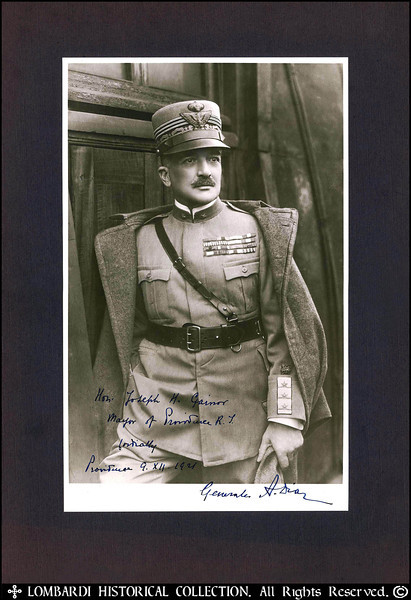 "COMMANDO SUPREMO, GENERAL ARMANDO DIAZ<br /> <br /> Autographed and Inscribed photo of World War I Italian Commando Supremo, General Armando Diaz. (1861-1928)  15"" x 10 1/2"". <br /> <br /> Inscribed in blue ink to: ""Hon. Joseph H. Gainor, Mayor of Providence, R. I., Cordially, Providence 9.XII.1921, Generales A. Diaz"". <br /> <br /> Armando Diaz was born in 1861. He joined the Italian Army and was a successful field commander in the Turkish War (1911-12) and was a member of the general staff under General Luigi Cadorna on the outbreak of the First World War in August 1914. Diaz was given a divisional command in May 1915 and was one of the more successful generals during the Isonzo Offensive and the victory at Gorizia in August 1916. Following the disastrous Battle of Caporetto, October 24, 1917, in which all the fruits of earlier campaigns were lost, Diaz succeeded Cadorna as commander-in-chief of the Italian armies. In nine days, June 15-23, 1918, Diaz decisively repulsed a great Austrian offensive designed to crush the Italian armies, driving the Austrians back across the Piave and inflicting enormous losses. After four months' preparation, Diaz began, October 24, a tremendous counterattack against the Austrian lines in Italy. These soon began to crumble under his well-directed blows. A series of increasing successes resulted at the end of ten days in the total collapse and rout of the Austrian forces. When Austria, on November 4, accepted terms of truce, a virtual surrender which hastened the impending downfall of Germany, the Italian armies under Diaz had captured 300,000 prisoners, 5,000 guns, and military booty valued at about a billion dollars. This victory by Diaz ranks as one of the most overwhelming in military history. In 1921 Benito Mussolini appointed Diaz as his war minister. He retained the post until his promotion to field marshal and retirement in 1924. Armando Diaz died in 1928."