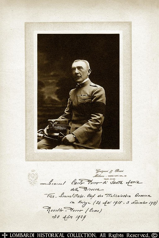 "GENERAL CARLO PORRO DI SANTA MARIA   Signed and Inscribed photograph of <b>GENERAL CARLO PORRO DI SANTA MARIA (1854-1939)</b>, Chief of Staff to Italian Commando Supremo, General Luigi Cadorna during the First World War.  A former Colonel of Artillery. It was Porro who recommended and introduced the Czech Legion into the Italian Army. After the Fall of Caporetto it was Porro along with Cadorna who bore the brunt of the blame for the disaster. Later he was appointed Minister of State by Mussolini. He was a Knight of the Order of the SS. Maurizio and Lazzaro. In 1916 he received the Grand Military Order of Italy. Photo by Guigoni & Bossi, silver print, 4""x5½"" three-quarter length portrait laid to photographer's mat, overall 7½""x12¼"". Darkly signed on mat beneath image, adding his different commands and dated ""30 March 1924."""