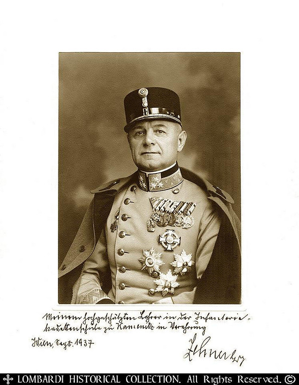"GENERAL WILHELM ZEHNER<br /> <br /> Signed autographed photo of Austrian General Wilhelm Zehner. 11 1/2"" x 8 1/2"". Photo by 'Heereslichtbildstelle Wien VI, Gumpendorferstr. 1, Vienna. With double-headed eagle. Sept. 1937. <br /> <br /> Inscription in his own hand, reads: ""Meinem hochgeschaetzten Lehrer der Infantrie-Kadettenschule zu Kamenitz in Verehrung Zehner, Wien Sept. 1937"" (Translation: To my highly regarded Teacher at the Infantry-Cadet-School at Kamenitz with respect, Zehner, Vienna, Sept. 1937.) <br /> <br /> Wilhelm Zehner was born 1883 in Siebenbuergen, Austrian-Hungarian Empire. Served heroically in WWI against Italy, and Russia, and climbed the ladder of military ranks, gathering many decorations. Became State Secy for the Army in Post- WWI Austria under Dr. Dollfuss in 1934. Dollfuss was assassinated by the SS, Zehner rose to the rank of General of Infantry. In 1938 he was incorporated into the WWII German Wehrmacht.<br /> <br /> Considered an enemy of the Nazis, the General was found dead in his home with a gun in his hand the same year. Though reported as suicide it is more likely he too was murdered. The photo shows Zehner in uniform looking straight into the camera, his chest filled with medals, 6 Edelweiss on his collar, with cape and decorated hat. His nickname was ""IRON ZEHNER""."