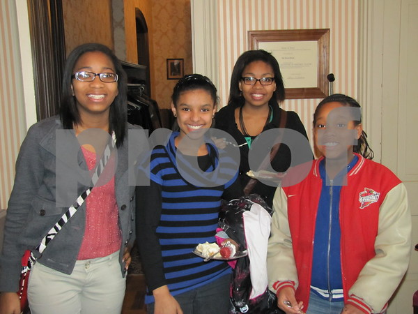 Jameka Mosley, Nasharia Patterson, Christyn Nichols, and LaJoyce Lee enjoy refreshments after the program celebrating Black History held at the Vincent House.