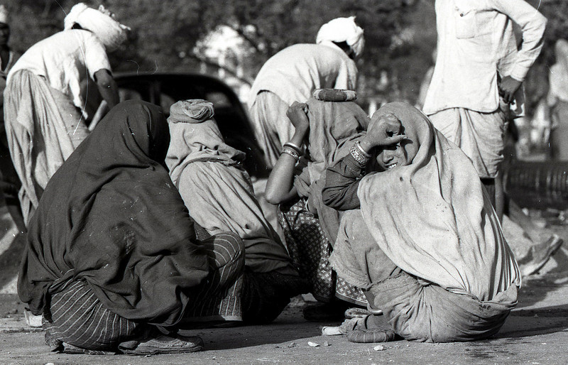 Road crew, Connaught Place. The women carried enormous loads of gravel on their heads to the men who spread it in the road bed.