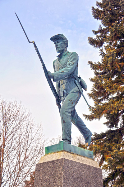 U.S. Civil War veteran Sam Smith is honored with a striking memorial statue at Summit Cemetery in Morris, Minnesota. Sam was a significant early resident of Morris which was founded in 1871. He served with distinction in the Union army for key engagements. This statue closely resembles the monument to the First Minnesota Volunteer Regiment at Gettysburg, Pennsylvania. The myth grew that Sam posed for that statue, but research has shown that to be most likely not true.