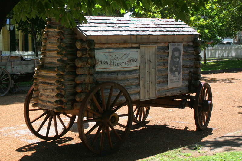 Not sure the story on this...I assume it to be a replica of a unique wagon used by Lincoln during one of his campaigns.  As you can see, Mr. Lincoln was not embarrassed by his humble beginnings but rather used them to relate to working-class Americans.