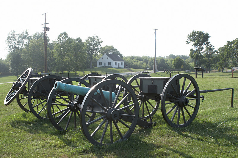Confederate limbers pull a gun and caissons in front of the Dunker Church at Sharpsburg, Maryland. Also known as the battle of Antietam.