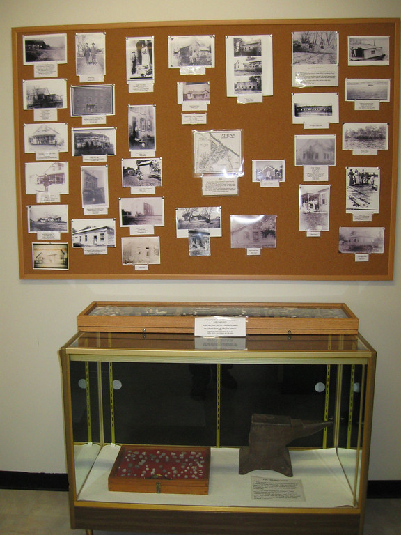 A cork board displays pictures older pictures of the town which help illustrate the fact that the area wasn't always so sleepy.  Below is an anvil used by the local southern militia for repairs and fieldwork while a small case displays the variety of ammunition used in the battle...