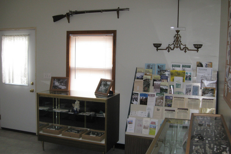 A Model 1861 Springfield rifle hangs above the window next to the entryway...there, now you've seen all four walls of the visitors room, now out onto the battlefield...