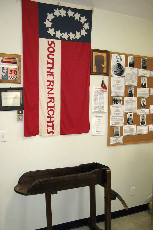 The southern flag hanging on the wall of the informational room is a replica of the one carried by southern troops that day.  Below it is a tobacco cutter which dates back to the 19th-Century...