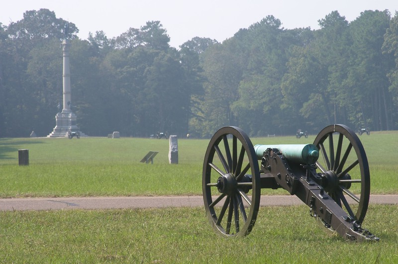 Federal cannon in the foreground with the Georgia monument and Confederate cannon, opposite, in the background - Chickamauga and Chattanooga National Military Park