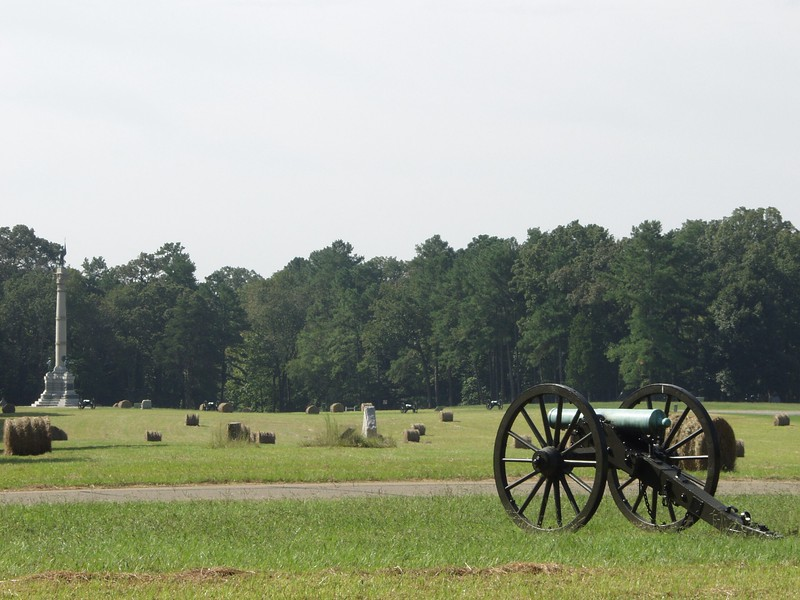 Federal cannon, in the foreground, repel the assault of Confederate troops on Poe Field at Chickamauga, Georgia.