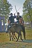 En guarde'! Cavalry demonstration of swordfighting on horseback. Ft Scott National Historical Site Civil War Encampment, Ft Scott, Kansas.