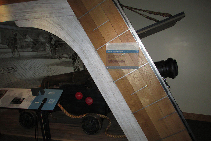 Along one wall was a cross-section view of one of the gun boats Grant used against the fort...