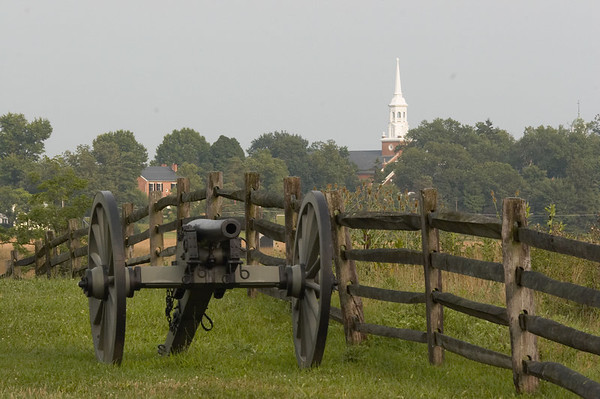 Federal cannon at the beginning of the battle of Gettysburg, Pennsylvania, with the town in the background, July 1, 1863.