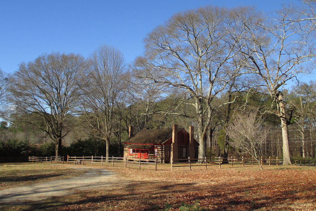Battle of Kolb's Farm - June 22, 1864 - 5:00pm -- A bloody prelude to the greater battle which would take place in the coming days took place here, at the farm of Peter Kolb, just south of Kennesaw Mountain.  General Hood (CSA) was convinced he could, with a bit of pressure, turn Sherman's line and prevent a flanking movement by the Federals around his position at Kennesaw.  Unfortunately for the Rebels, inadequate reconnaissance resulted in their coming up against a Union line much stronger than they anticipated and, after a brief but intense struggle, were repulsed after taking over 1,500 casualties.  In contrast the Federal forces only lost around 250.    The bucolic scene which surrounds the old farmhouse today belies the violent events that took place here 150 years ago although if you look close you can see evidence in the tree to the far right.  About halfway up, the trunk is noticeably deformed.  This was likely caused by battle damage to the tree, possibly a cannonball which took the top off of it...